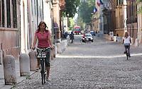 In bicicletta su un caratteristico acciottolato di Ferrara.<br /> Cyclists on cobblestone streets in Ferrara.<br /> UPDATE IMAGES PRESS/Riccardo De Luca