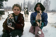 Midway Salcha Area, Alaska, U.S.A, January 1989. A sudden cold wave struck Alaska resulting to the temperature falling under 50 degrees Centigrade (58 degrees Fahrenheit). Kids and dogs.