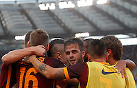 Calcio, Serie A: Roma vs Juventus. Roma, stadio Olimpico, 30 agosto 2015.<br /> Roma&rsquo;s Miralem Pjanic, center, celebrates with teammates after scoring during the Italian Serie A football match between Roma and Juventus at Rome's Olympic stadium, 30 August 2015.<br /> UPDATE IMAGES PRESS/Riccardo De Luca