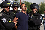 """Israeli policemen detain a Palestinian protester during a demonstration marking the 66th anniversary of the """"Nakba,"""" meaning catastrophe, when many Palestinians fled or were expelled from their towns and villages during the war of Israel's foundation in 1948, at Damascus Gate in Jerusalem's Old City May 15, 2014. An Israeli police spokesman said on Thursday that 5 Palestinian protesters were detained during the unauthorized demonstration in Jerusalem's Old City, where stones were thrown at policemen and an Israeli flag was burnt. Also on Thursday, Israeli forces shot dead two Palestinians during a stone-throwing protest marking the """"Nakba"""" in the occupied West Bank. Photo by Saeed Qaq"""