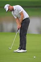 Chris Kirk (USA) putts on the 11th green during Friday's Round 2 of the 2014 BMW Masters held at Lake Malaren, Shanghai, China 31st October 2014.<br /> Picture: Eoin Clarke www.golffile.ie