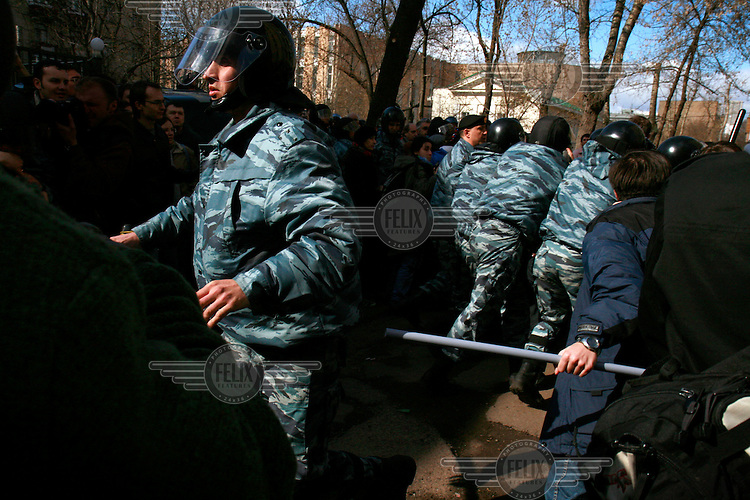 OMON Special Forces beat a crowd of peaceful protesters with truncheons. .Police detained Garry Kasparov, leader of the United Civil Front group (part of the opposition coalition The Other Russia), and about 170 other activists as they gathered for a forbidden anti-Kremlin demonstration in central Moscow..The demonstration, one in a series of so-called Dissenters' Marches, protested against the government crackdown on political dissent.