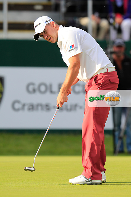 Richie RAMSAY (SCO) putts on the 18th green during Thursday's Round 1 of the 2014 Omega European Masters held at the Crans Montana Golf Club, Crans-sur-Sierre, Switzerland.: Picture Eoin Clarke, www.golffile.ie: 4th September 2014