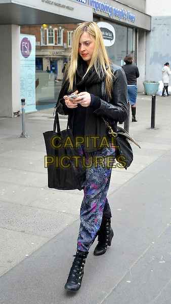 FEARNE COTTON.Leaving BBC Radio 1 this afternoon, London, England..March 10th, 2010.full length black boots bag purse jacket purple pink pattern trousers text texting mobile phone iphone .CAP/DYL.©Dylan/Capital Pictures.
