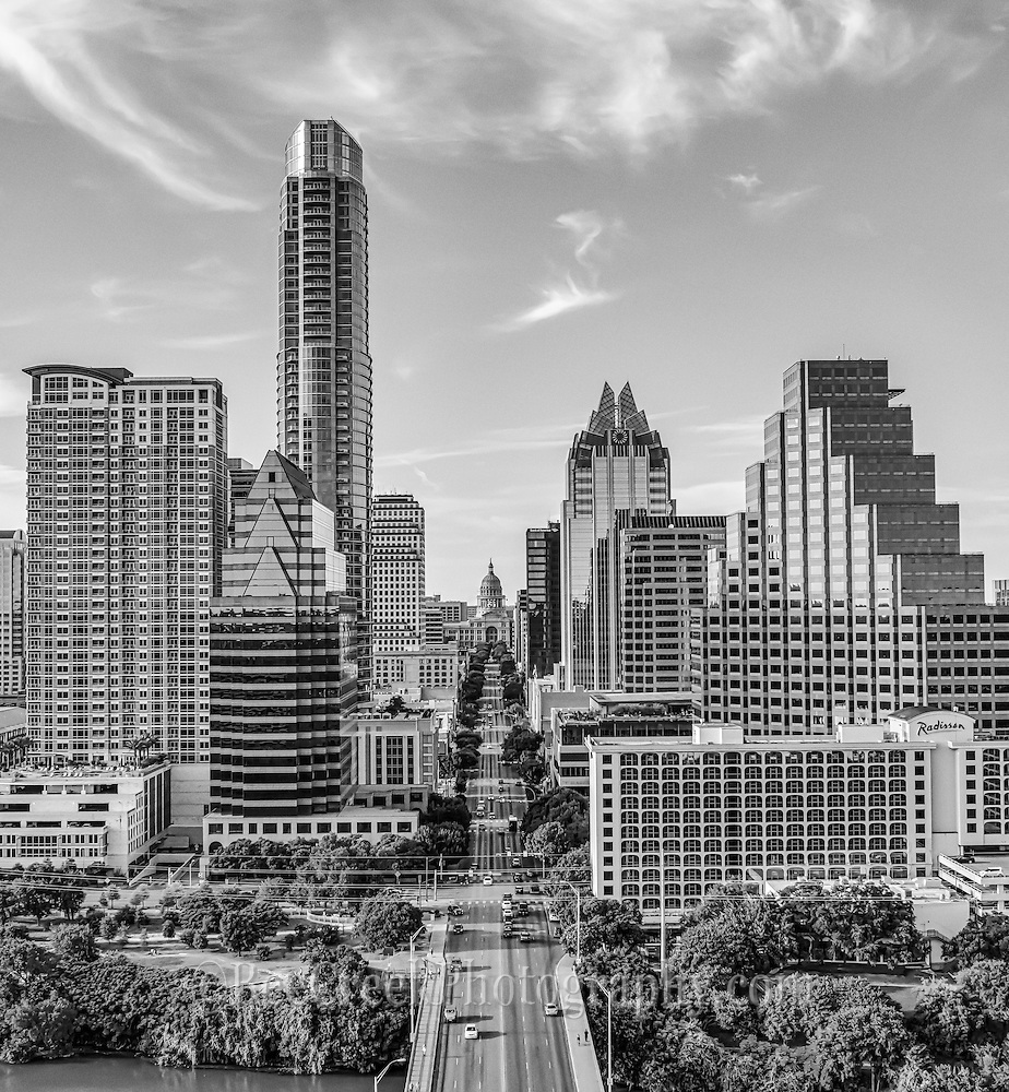 Austin skyline aerial black and white of Austin Texas. In this image you can see the Texas Capitol, the congress ave. bridge, and the tallest building in the city the Austonian along with the Frost building along with many other high rise downtown buildings.