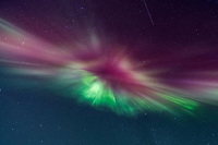 Coronal display over the sky in Fairbanks, Alaska. Aurora corona as seen when standing directly below a bundle of parallel plasma-channeling magnetic field lines that are converging on a point high in the sky.