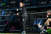 Seattle, WA - Sunday, April 17, 2016: Seattle Reign FC head coach Laura Harvey cheers her team on during the first half of the match, at Memorial Stadium. Sky Blue FC defeated the Seattle Reign FC 2-1during a National Women's Soccer League (NWSL) match at Memorial Stadium.