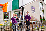 Gaelscoil in Killarney raising of an Irish flag to mark Proclamation Day celebrations last Tuesday morning. Pictured L-R Ashten Ni Meara, Sean O'Luanaigh (chairman of Board of Management), Proinsias Mac Curtain (School Principle) and  John O Mordha.