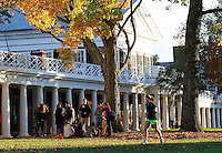 Students at the University of Virginia enjoy an afternoon under the fall leaves on the lawn outside the pavilions at UVa in Charlottesville, Va. Photo/Andrew Shurtleff