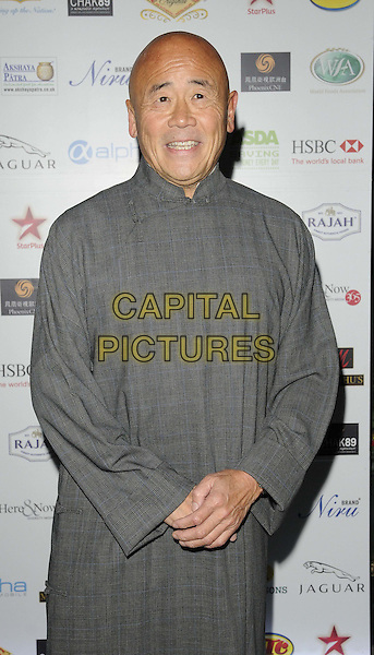 Ken Hom .attended the World Food Awards 2011, Grosvenor House hotel, Park Lane, London, England, UK, 1st October 2011..half length grey gray  checked tunic .CAP/CAN.©Can Nguyen/Capital Pictures.