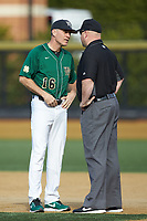 Wake Forest Demon Deacons head coach Tom Walter (16) argues a call with first base umpire Wilson Raynor during the game against the Louisville Cardinals at David F. Couch Ballpark on March 17, 2018 in  Winston-Salem, North Carolina.  The Cardinals defeated the Demon Deacons 11-6.  (Brian Westerholt/Four Seam Images)