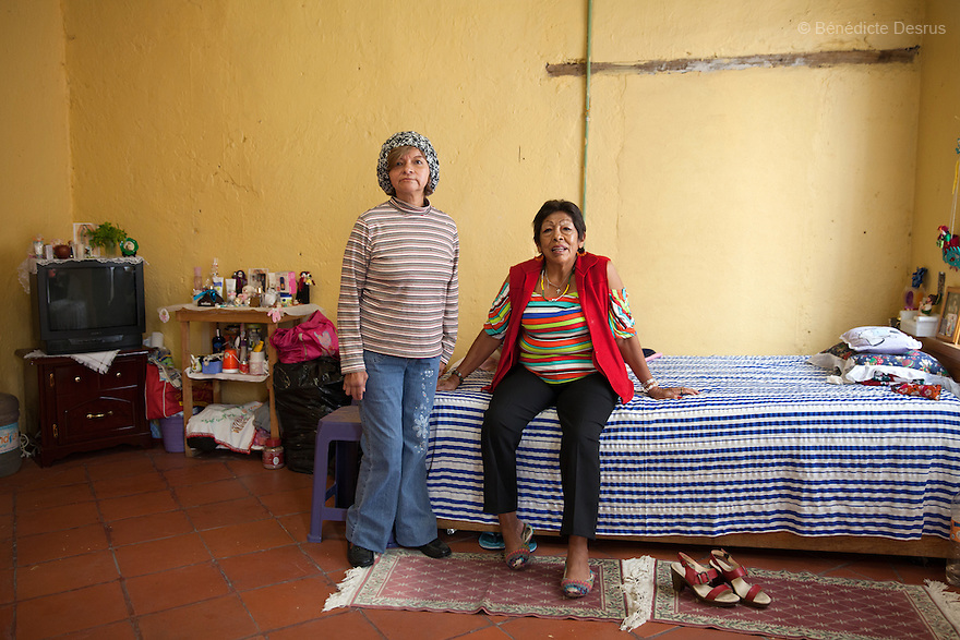 Portrait of Marta y Luchita, boh residents of Casa Xochiquetzal, at the shelter in Mexico City, Mexico on July 8, 2013. Casa Xochiquetzal is a shelter for elderly sex workers in Mexico City. It gives the women refuge, food, health services, a space to learn about their human rights and courses to help them rediscover their self-confidence and deal with traumatic aspects of their lives. Casa Xochiquetzal provides a space to age with dignity for a group of vulnerable women who are often invisible to society at large. It is the only such shelter existing in Latin America. Photo by Bénédicte Desrus