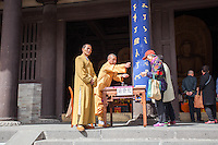 Buddhist monks in front of a temple at the Yungang Grottoes in Datong, China
