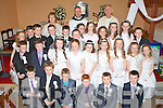 The pupils of Bhreanainn NS, Tralee, who made their First Holy Communion on Saturday in the Church of the Immaculate Conception, Ballymacelligott, pictured here with their teacher Kathleen Griffin, Fr Pat Crean Lynch and Fr Ger Godley.