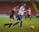 Chris Basham of Sheffield United tussles with Danny Mayor of Bury during the English Football League One match at Bramall Lane, Sheffield. Picture date: November 22nd, 2016. Pic Jamie Tyerman/Sportimage
