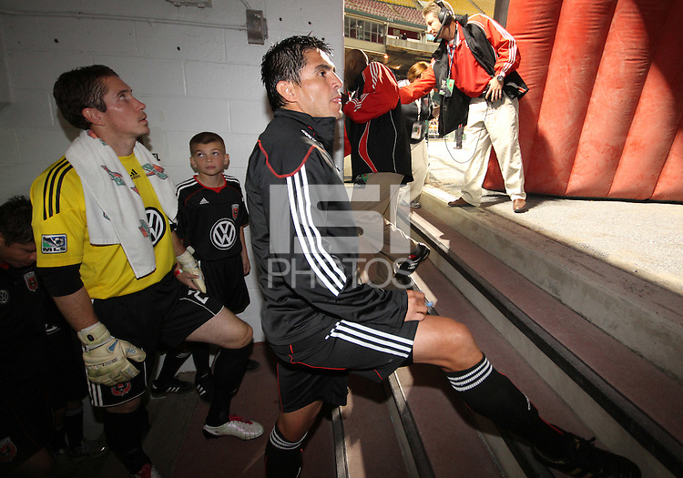 Jaime Moreno with Troy Perkins get ready to enter the field in Jaime's last appearance in a D.C. United uniform, at RFK Stadium, in Washington D.C. on October 23, 2010.