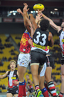 Players compete for a high ball during the Australian Rules Football ANZAC Day match between St Kilda Saints and Brisbane Lions at Westpac Stadium, Wellington, New Zealand on Friday, 25 April 2014. Photo: Dave Lintott / lintottphoto.co.nz