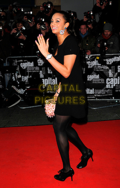 ALESHA DIXON.Arrive for the Capital Radio 95.8 FM Awards in aid of Help a London Child, held at Riverbank Park Plaza Hotel, London, England 20th March 2008. .full length hand waving black dress.CAP/CAN.©Can Nguyen/Capital Pictures