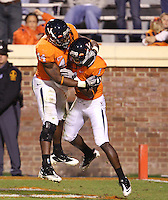 Oct 23, 2010; Charlottesville, VA, USA;  Virginia Cavaliers running back Raynard Horne (44) celebrates the touchdown of Virginia Cavaliers safety Trey Womack (1) during the 2nd half of the game against Eastern Michigan Eagles at Scott Stadium. Virginia won 48-21. Mandatory Credit: Andrew Shurtleff