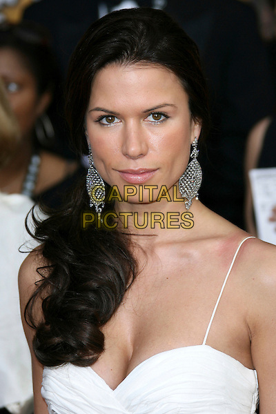 RHONA MITRA.12th Annual Screen Actors Guild Awards (SAG) held at the Shrine Auditorium, Los Angeles, California, USA.  .January 29th, 2006.Photo: Zach Lipp/AdMedia/Capital Pictures.Ref: ZL/ADM.headshot portrait dangling silver earrings.www.capitalpictures.com.sales@capitalpictures.com.© Capital Pictures.