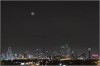 On a cold December evening with the moon rising into the night sky, the Dallas skyline comes alive with color. From left to right, the architecture of Dallas offers the Margaret Hunt Hill Bridge, the Trammell Crow Tower, the Fountain Place, Lincoln Plaza, the Harward Center, Energy Plaza, the Renaissance Tower, the Bank of America Plaza, the CoAmerica Bank Tower, the Hyatt Regency Dallas,  the iconic Reunioin Tower, and the Omni Hotel Dallas (the blue and red building). Also, the full moon rising over the city peaked through the low clouds...Thanks to the Belmont Hotel for provided this vantage point. They were great to work with.