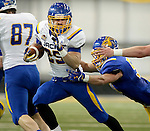 BROOKINGS, SD - APRIL 23:  Clark Wieneke #25 from South Dakota State tries to slip the grasp of RJ Helsper #50 during their Spring Game Saturday afternoon at the Sanford Jackrabbit Athletic Complex in Brookings.  (Photo by Dave Eggen/Inertia)
