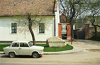 "The Kiralyudvar winery in the village Tarcal: the sign to the winery is made from a rock from the typical porous volcanic soil. An old Trabant car in front. Kiralyudvar (meaning ""King's Court"")is run by Istvan Szepsy, considered maybe the best winemaker in Tokaj. he also makes Tokaj under his own name.  Credit Per Karlsson BKWine.com"