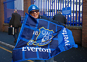 2nd December 2017, Goodison Park, Liverpool, England; EPL Premier League football, Everton versus Huddersfield Town; An Everton fan from Malaysia waves their flag outside the ground before the game