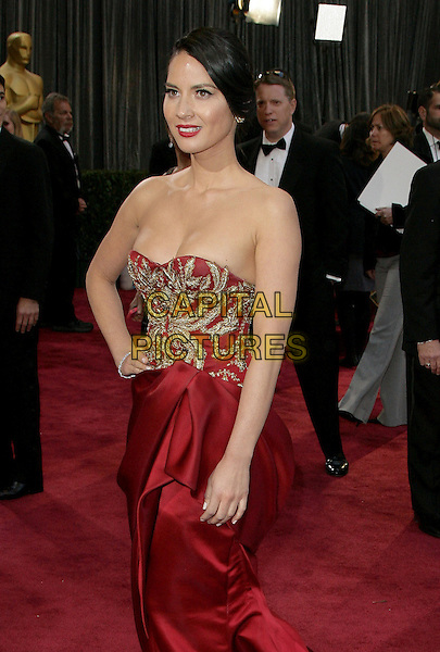 Olivia Munn (wearing Marchesa).85th Annual Academy Awards held at the Dolby Theatre at Hollywood & Highland Center, Hollywood, California, USA..February 24th, 2013.oscars half length red gold embroidered strapless silk satin dress hand on hip.CAP/ADM.©AdMedia/Capital Pictures.