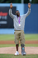 Manteo Mitchell Olympic Silver Medalist in the 4 x 400 prepares to throw out the first pitch before  a game Greenville Drive and the Asheville Tourists at McCormick Field on August 18, 2012 in Asheville, North Carolina. The Tourists defeated the Drive 12-2 (Tony Farlow/Four Seam Images).
