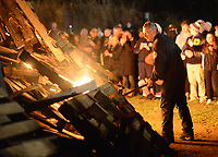A firefighter checks on the stage of the bonfire during a pep rally to cheer on the Palisades High School football team Thursday, November 16, 2017 at Palisades Middle School in Kintnersville. Palisades, 11-0 this season, will be playing Lehighton on Saturday for the PIAA District 11 Class 3A title at Bethlehem School District Stadium. (Photo by William Thomas Cain)