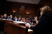 Rachel Mitchell (R), a prosecutor from Arizona, asks questions to Christine Blasey Ford (L), the woman accusing Supreme Court nominee Brett Kavanaugh of sexually assaulting her at a party 36 years ago, before the US Senate Judiciary Committee on Capitol Hill in Washington, DC, September 27, 2018.  / POOL / SAUL LOEB