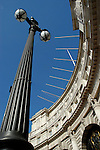 Dramatic view looking up from the bottom of Admiralty Arch, with old streetlamp in the foreground, London, England