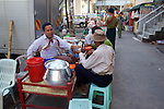 Street Vendor Selling Food Near Gyee Zai Market