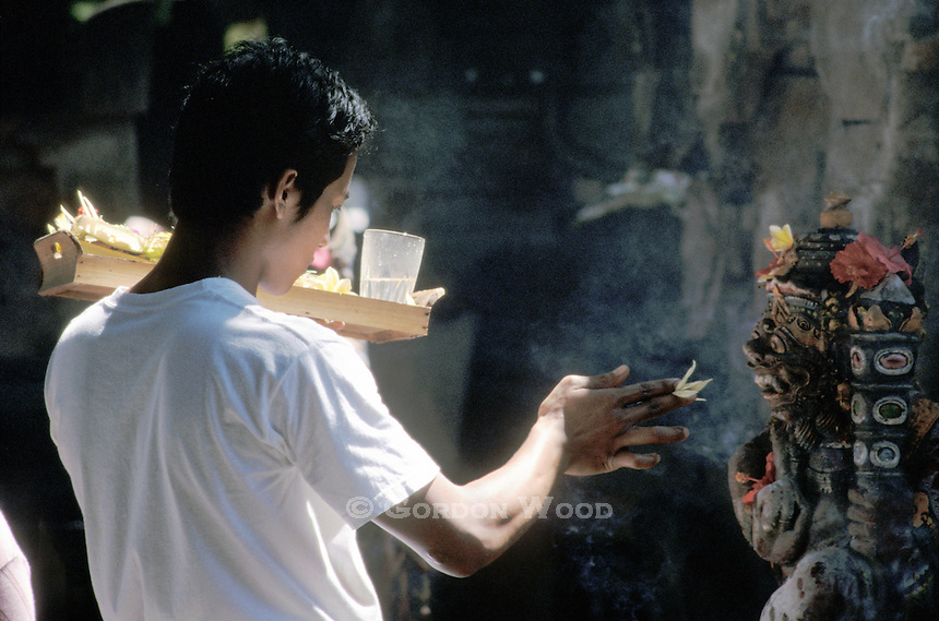 Young Man's Offerings to a God - Bali, Indonesia