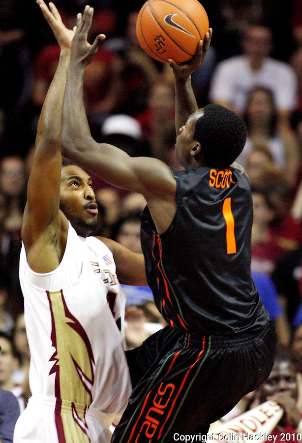 TALLAHASSEE, FL 2/6/10-FSU-MIAMI BB10 CH05-Florida State's Ryan Reid gets in front of Miami's Durand Scott during first half action Saturday at the Donald L. Tucker Center in Tallahassee...COLIN HACKLEY PHOTO