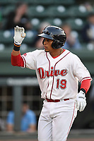 Catcher Isaias Lucena (19) of the Greenville Drive in a game against the Rome Braves on Thursday, April 12, 2018, at Fluor Field at the West End in Greenville, South Carolina. Greenville won, 14-4. (Tom Priddy/Four Seam Images)