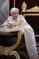 Pope Benedict XVI prays during the Vesper ceremony in the St. Peter's basilica at Vatican on February 2, 2010