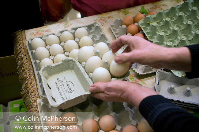 Ian Lloyd  of Leadgate Farm Eggs working on his stall at the Wirral Farmers' Market. The Wirral Farmers' Market was established six years ago and is held on a Saturday each month at New Ferry Village Hall on the Wirral. Producers come from accross the north west of England to sell their produce.