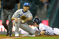 Third baseman Tyler Rahmatulla #5 of the UCLA Bruins waits for a throw as Brock Holt #7 of the Rice Owls slides in during the 2009 Houston College Classic at Minute Maid Park February 27, 2009 in Houston, TX.  The Owls defeated the Bruins 5-4 in 10 innings. (Photo by Brian Westerholt / Four Seam Images)
