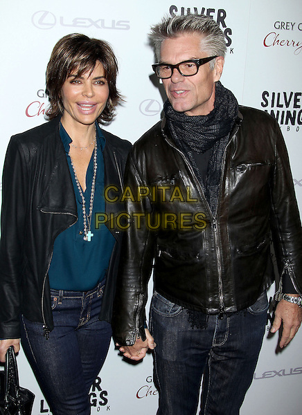 "Lisa Rinna, Harry Hamlin.""Silver Linings Playbook"" - Los Angeles Special Screening held at the Academy of Motion Picture Arts and Sciences Samuel Goldwyn Theater, Beverly Hills, California, USA..November 19th, 2012.half length black leather jacket glasses brown teal blue top beads necklace married husband wife scarf jeans denim mouth open smiling holding hands .CAP/ADM/RE.©Russ Elliot/AdMedia/Capital Pictures."