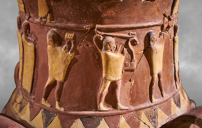 Close up of the Inandik Hittite relief decorated cult libation vase decorated with relif figures coloured in cream, red and black. The processional figures include musicians and acrobats, mid to late 16th century BC - İnandıktepe, Turkey