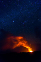 New Year's Day 2017: Stars glitter in the night sky above the brand new lava hose created by a collapsed 23-acre lava bench just hours earlier, Kamokuna, Hawai'i Volcanoes National Park, Big Island.