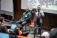 Nike Inc. representatives Nohan Cruz, Talent Attraction Coach (standing) and Dexter Green, Territory Account Executive, talk to Occidental College students at the Nike//unLock Info Session, discussing careers at the company. Hosted by Career Services, Choi Auditorium, Oct. 11, 2018.<br /> (Photo by Marc Campos, Occidental College Photographer)