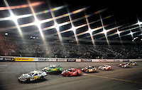 May 1, 2009; Richmond, VA, USA; (Editors Note: Special effects filter used in creation of this image) NASCAR Nationwide Series driver Kenny Wallace (28) leads a pack of cars during the Lipton Tea 250 at the Richmond International Raceway. Mandatory Credit: Mark J. Rebilas-