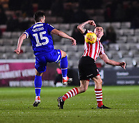 Lincoln City's Scott Wharton vies for possession with Morecambe's Aaron Wildig<br /> <br /> Photographer Andrew Vaughan/CameraSport<br /> <br /> The EFL Sky Bet League Two - Saturday 15th December 2018 - Lincoln City v Morecambe - Sincil Bank - Lincoln<br /> <br /> World Copyright © 2018 CameraSport. All rights reserved. 43 Linden Ave. Countesthorpe. Leicester. England. LE8 5PG - Tel: +44 (0) 116 277 4147 - admin@camerasport.com - www.camerasport.com