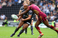 PICTURE BY ALEX WHITEHEAD/SWPIX.COM - Rugby League - Super League - Hull FC v Huddersfield Giants - KC Stadium, Hull, England - 01/07/12 - Hull's Aaron Heremaia passes the ball before being tackled by Huddersfield's Michael Lawrence.