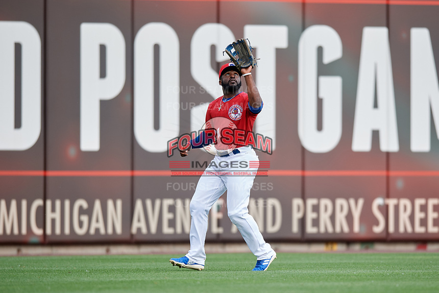 Buffalo Bisons left fielder Dwight Smith Jr. (21) settles under a fly ball during a game against the Lehigh Valley IronPigs on June 23, 2018 at Coca-Cola Field in Buffalo, New York.  Lehigh Valley defeated Buffalo 4-1.  (Mike Janes/Four Seam Images)