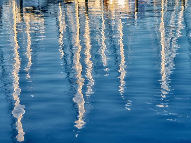 Reflected sailing masts at Monterey Harbor and Marina, California