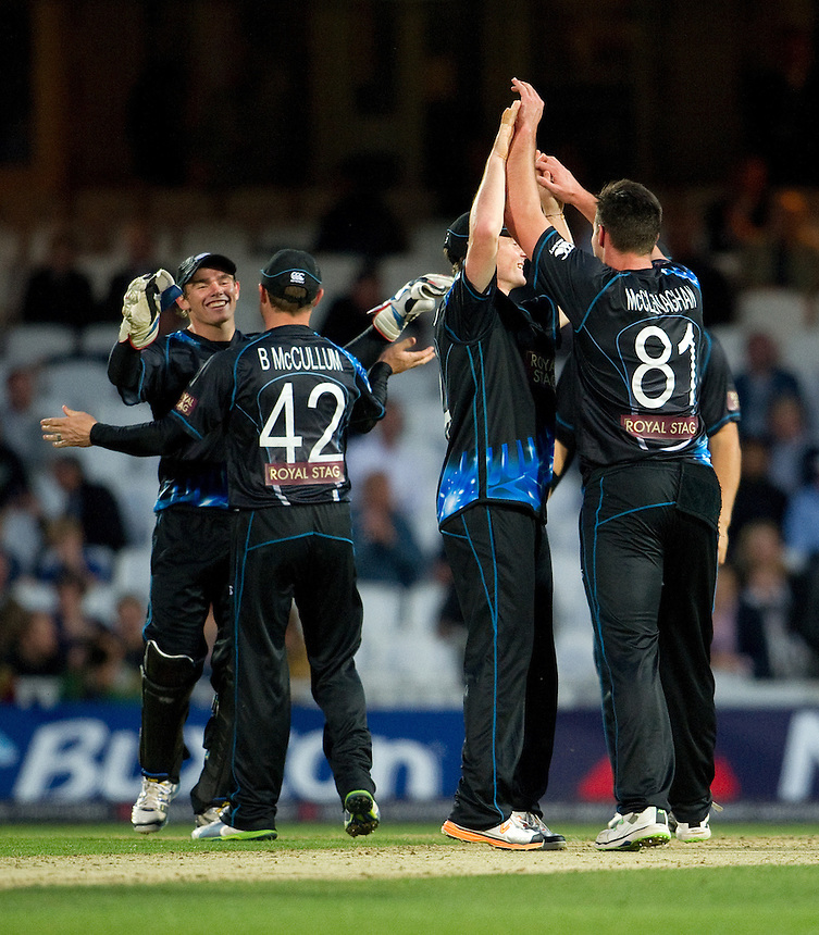New Zealand players celebrate the dismissal of England's Luke Wright <br /> <br />  (Photo by Ashley Western/CameraSport) <br /> <br /> International Cricket - NatWest International T20 Series - England v New  Zealand - Tuesday 25th June 2013 - The Kia Oval, London <br /> <br />  &copy; CameraSport - 43 Linden Ave. Countesthorpe. Leicester. England. LE8 5PG - Tel: +44 (0) 116 277 4147 - admin@camerasport.com - www.camerasport.com